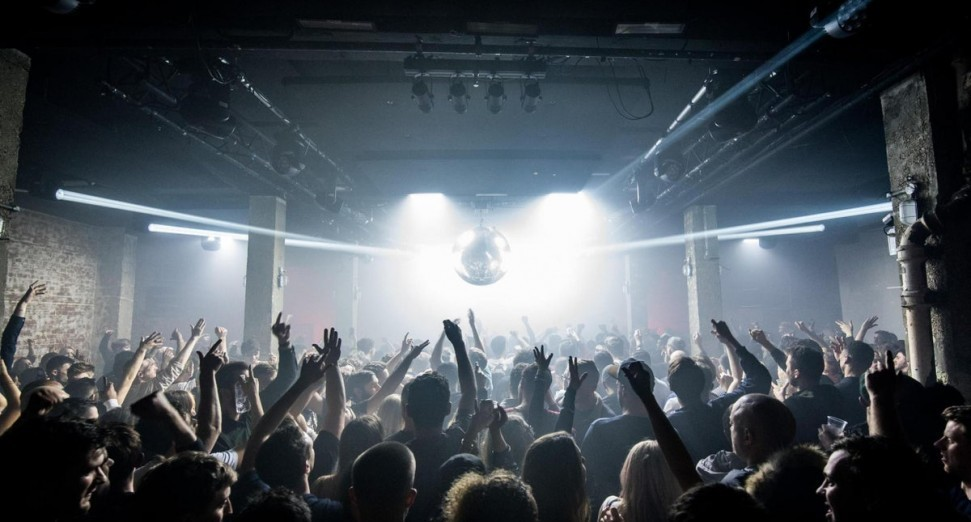 Thousands flock to clubs and festivals in England as restrictions are lifted